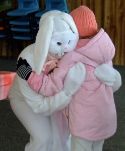 Okay, I know this is supposed to depict a sweet, heartwarming moment. But I just can't help but cringe when looking at this. Seriously, that bunny is terrifying.