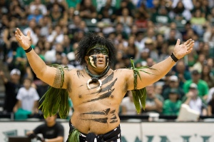 Okay, now I'm sure Hawaii has a lot of Polynesians in the area. But I can't help that he seems to embody the offensive savage native sacrifice your white women persona as I see it. I'm not sure if he's still the school's mascot or not.