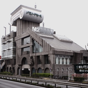 This is the Mazda 2 Building in Tokyo, Japan or as I call it, a lousy attempt at Art Deco. Still, I think Godzilla smashing this building would improve its looks.