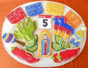 Now these cookies are of May 5th, pinatas, Mesoamerican temple art, cacti, maracas, chili peppers, limes, Our Lady of Guadelupe, and Corona. And I identified all that without consulting Wikipedia.