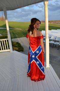 Of course, I'd like to know how she'll have to explain this to her black boyfriend. Seriously, the Confederate Flag is a racist symbol since it was used by white supremacist organizations like the KKK and the Dixiecrats.