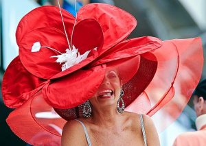 And this red flower seems to cover most of this woman's hat. Hope some bee doesn't mistake it for the real thing.