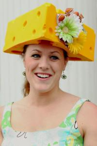 And she's wearing her cheesehead coiffure in all its Greenbay Packer glory. Seriously, whenever I see a cheese head, I think of the Greenbay Packers.