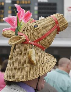 Yes, this guy sure looks pretty with a horse bonnet that has pink lilies on its ears. Also, has a rabbit's foot on it for luck. Guess he has money on a horse.