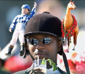 Seems like the jockey and horse are chilling right by his riding helmet. Let's hope he doesn't have money on a horse and is just there for the fun of it all.