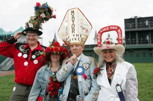 Nevertheless, Louisville's mayor has an ego about a mile wide. So on Kentucky Derby day, he thinks he's the Pope.