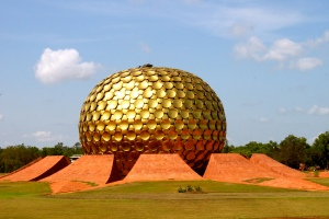 This is called the Matrimandir which is in Auroville, Bommayapalayam, Tamil Nadu in India. It's an edifice of spiritual significance for practitioners in integral yoga. However, to me, it's just a golden golf ball merged with EPCOT.