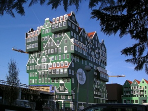 This is a building in Amsterdam in the Netherlands. Of course, it also kind of appears as if a bunch of houses were stacked up against each other. Yet, everything doesn't seem to match.