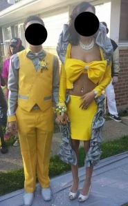 Now I know my school would never let me wear that yellow dress for prom. However, it's the gray trimmings that irk me with this outfit. Seriously, makes the girl look like she's straight from a Sci-fi TV show.