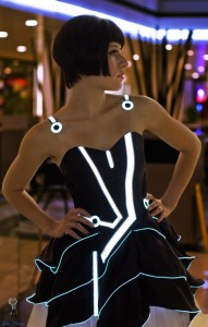 Hey, girl, you might want to save your TRON dress for the geek convention where it will be a hit with the nerds. Either that, or the Black Eyed Peas Super Bowl concert.