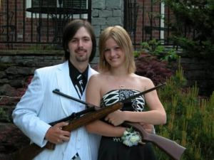 Now it's one thing to take a prom photo with guns. It's a whole different matter when the guy is dressed up like a 1920s gangster. And the fact it's so unintentional makes it even funnier.
