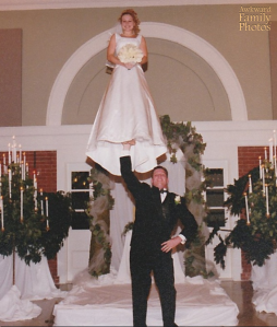 Yeah, lifting the bride flat on her back wasn't much of a challenge to him. He had to literally sweep her and then grab her from her feet.