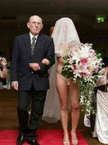 Just love the look on her dad's face as he walks her down the aisle. Yeah, I'm sure he told her time and time again to dress nice but   she doesn't seem to have listened to him one bit.