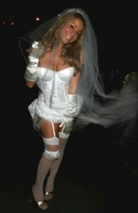 I think this might be Mariah Carey on her wedding day. Not sure why she's no wearing a skirt under her garters.
