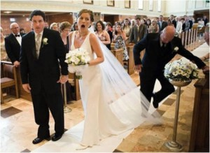 I'm sure this mishap happens a lot at weddings. Hope the bride 's scalp is all right. Still pretty funny.