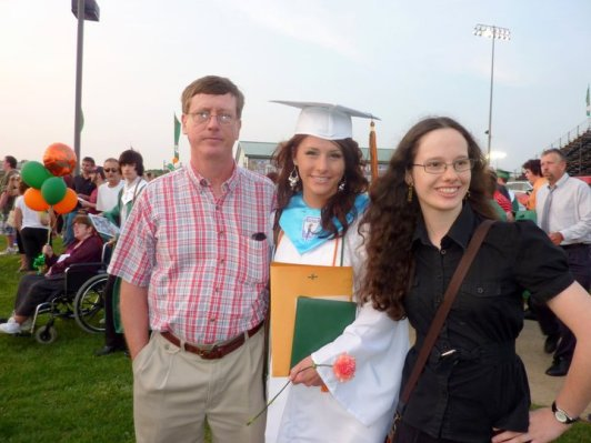Me with my father and sister at my sister's high school graduation in 2011.