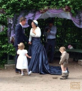Well, at least the ring bearer didn't go on that woman's skirt. But I wonder if anyone in this photo seems to notice other than the person taking the picture.