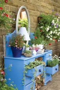 I'm sure you can't put clothes in this. But flowers it will do. Hope the rain doesn't take the paint off.