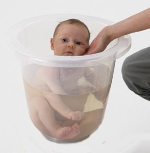 It's basically a bucket that costs $45 that's supposed to replicate the feeling of being in the womb. Nevertheless, if that does the trick, you should just hold on to your $45 and use a regular bucket, which comes with a handle.