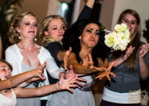 Because like any variety of sport, bouquet catching brings you the drama of athletic competition from the thrill of victory to the agony of defeat. Seriously, it's just a stupid bouquet, nothing to get all worked up about.