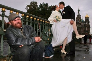 Of course, in Russia the presence of a homeless guy could mean the seriousness and hard work of marriage. Or perhaps a reminder of what would happen to the husband if he drinks too much vodka. Then again, Russia isn't a happy place.