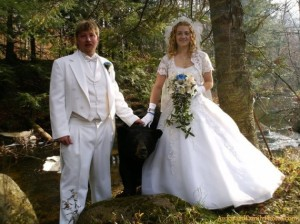 Four year old boys to carry rings? Gah! They have a black bear. Of course, having a black bear carry jewelry down the aisle does run the risk of having some of the guests eaten alive during the ceremony. Also, most churches don't allow pets, let alone wild animals for God's sake. Okay, maybe 4 year old ring bearers aren't such a bad idea.