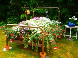 "Now this one takes the concept of ""flower bed"" a bit more literally than most. Of course, it uses an actual metal bed."