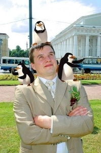 As to what the hell the penguins of Madagascar have with weddings, I have no idea. But apparently, the Russians might have the answer, somewhat. Still, probably would've been a conventional wedding photo without the magic of photoshop.