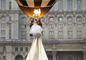 Fortunately, the brides extraordinary long train makes a dandy safety procedure in the event of an emergency. Of course, they might need to inflict some damage to  tie it to a basket.