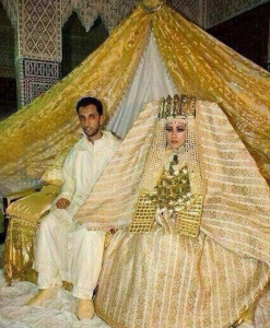I'm sure part of the curtain rod is within her wedding crown piece. Still, I've seen nice Muslim style wedding dresses and some of them are quite nice. This one is beyond tacky. Still, kind of reminds me of what you'd see an Egyptian Pharaoh would wear in increment weather.
