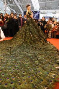 Wonder how many male birds had to die to make this dress. Also, it seems to have a very long train that covers most of the floor.