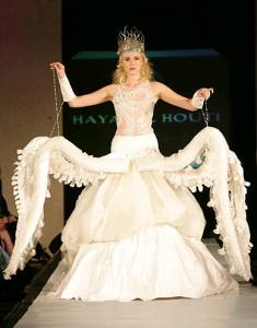 Seriously, putting tentacles on a dress is a horrible idea that even the model  can't hide her dismay. Seriously, no girl wants to be married in a dress that makes her look like an octopus!