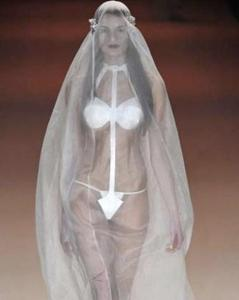 Now this kind of reminds me of a woman in a sci-fi film who's entrenched in a full body bag she can walk in. Well, at least the veil would come in handy protecting her against mosquitoes during her wedding in sub Sahara Africa.