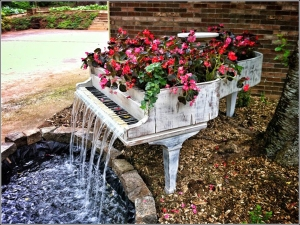 Sure it's a bit water logged and won't play a note. But at least the flowers and waterfall are pretty.