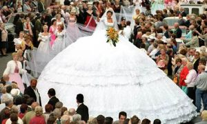 O my God, why would think of getting a wedding dress with skirt that big? Then again, perhaps it will be used for the happy couple's tent when they go on their honeymoon or something.