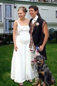 This photo seems to have all the trappings of a shotgun wedding. I mean the bride is obviously pregnant but there's nothing really objectionable about her dress. However, the groom's only formal attire is a black vest and possibly a white collar and tie. And I suppose the plaid shirt and pants have seen better days. Seriously, a guy should look his best on his wedding day, not like he's just marrying the girl to escape the wrath of daddy's shotgun!