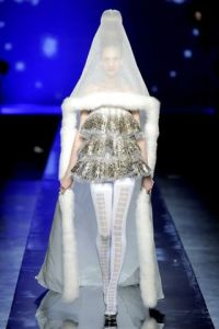 For one, this looks the kind of wedding dress you'd see in a sci-fi movie. Secondly, that veil just looks hideous with the short dress. But I'm sure her face will be fine against the mosquitoes.