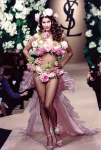 Oh, hell no! Seriously, having flowers on your wedding dress is fine. But  walking down the aisle looking like a Victoria's Secret model? Definitely not! I mean why?