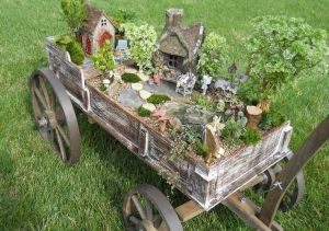 Also, if your miniature garden is in a wagon, it's easier to transport and you don't have to worry about potentially dumping it, unlike a wheelbarrow. Still, it's quite beautiful and an ideal fairy mecca as I see it.