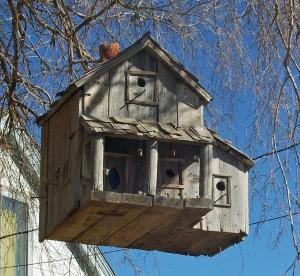 Now I think this might be a bird farmhouse made from scrap wood. But I'm sure it'll have plenty of room with stores of birdseed in the pantry.