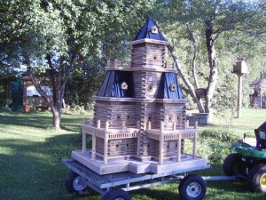 Now this seems like a castle because it just appears so big from other birdhouses. But if it was in better proportion it would resemble something like a Victorian house. Still, it was either sitting in the garage for long periods or someone just had too much time on their hands.