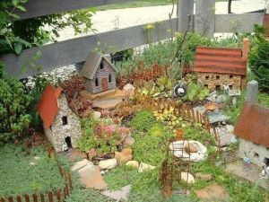 This little corner has a church, a birdhouse, a wheelbarrow, and a happy little tire swing.  Also, has a few little figures, too.