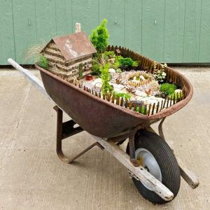 Of course, this place has a lot of plants as well as some farm animals. Still, as a whole it looks wonderful. See I said that you can use any container for a miniature garden. Even a wheelbarrow.