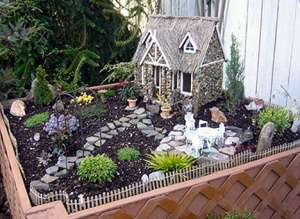 As I've said miniature garden designs can get very elaborate and this is no exception. Still, you would more likely see this as your next door neighbor's place than a fairy though.