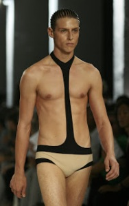 Okay, now this seems to be a cross between a speedo and a high school wrestling get up you'd see in Foxcatcher. As bad as speedos are in swimwear, they guy looks much better without the neck strap. Might want to give him scissors.