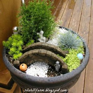 It's not uncommon for garden miniatures to contain waterways made from gravel than actual water. Just because real water doesn't really conform to aesthetics and would be absorbed by the plants.