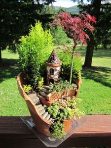 While broken  flower pots may not be used for regular plant, you can plant a miniature garden in one just fine, especially if you want it to include elevation like a garden path up to a house.