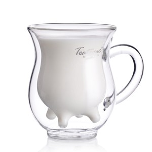 Now this is a Cow Breast Shaped Milk Glass Mug. You heard me. I'm sure no milk is coming from those udders or in them. Perfect for the dairy farmer's morning coffee.