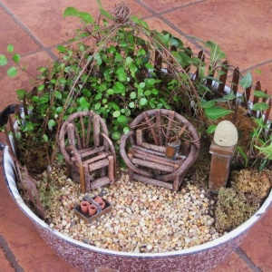 Now I like this kind of patio furniture. Quite rustic, I daresay. But I think the garden stuff and beehive is adorable.