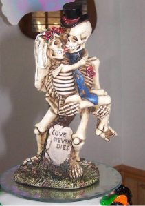 Now skeletons are one thing but French kissing skeletons over a grave? Now that's crazy. Even for a wedding on Halloween.